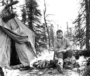 Goddard takes notes at a Dene hunting camp at the Arctic Circle on the Mackenzie River, N.W.T.